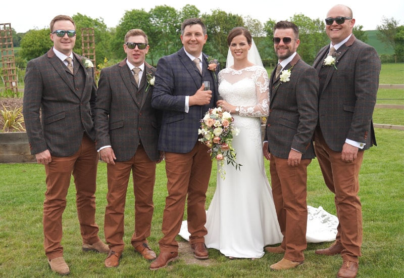 a wedding party outdoors at Nottinghamshire wedding venue Overgrown Acres